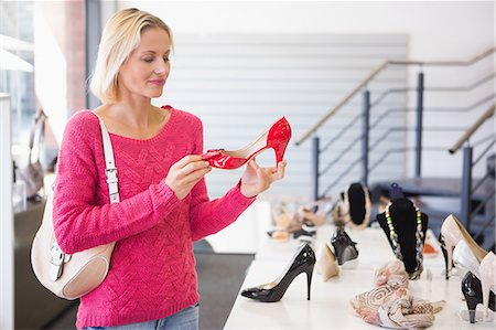 Pretty blonde shopping for shoes Stock Photo - Premium Royalty-Free, Code: 6109-08204439