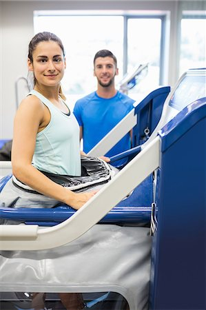 rehabilitation - Woman using an anti gravity treadmill beside trainer Stock Photo - Premium Royalty-Free, Code: 6109-08389481