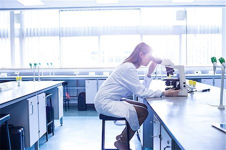 Scientist working with a microscope in laboratory Stock Photo - Premium Royalty-Free, Code: 6109-08389820