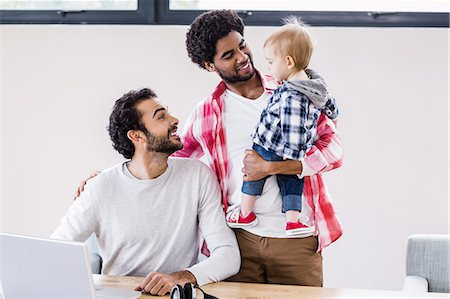 Happy gay couple with child Stock Photo - Premium Royalty-Free, Code: 6109-08390193