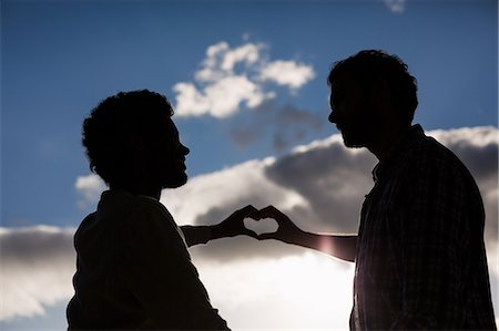Homosexual couple making hearth with hands Stock Photo - Premium Royalty-Free, Code: 6109-08390483