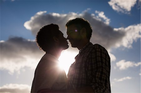 Homosexual couple nose-to-nose Stock Photo - Premium Royalty-Free, Code: 6109-08390482