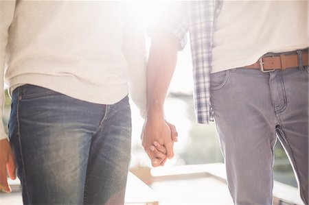 Close up of gay couple holding hands together Stock Photo - Premium Royalty-Free, Code: 6109-08390487