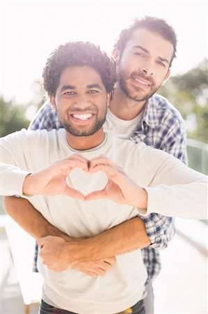 Happy gay couple hugging outdoors Stock Photo - Premium Royalty-Free, Code: 6109-08390486
