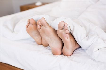 Feet of gay couple out of the blanket Stock Photo - Premium Royalty-Free, Code: 6109-08390410
