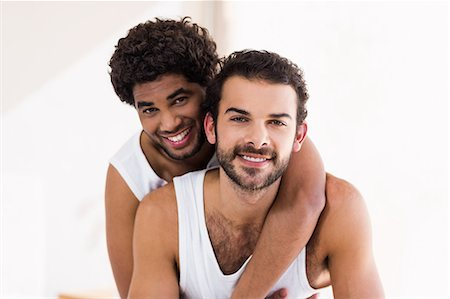 Portrait of happy gay couple hugging Stock Photo - Premium Royalty-Free, Code: 6109-08390423
