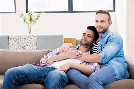 Gay couple relaxing on the couch Stock Photo - Premium Royalty-Free, Code: 6109-08390552