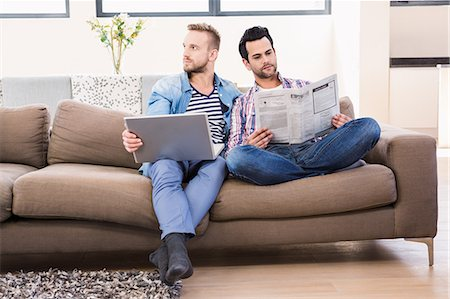 Gay couple relaxing on the couch Stock Photo - Premium Royalty-Free, Code: 6109-08390571