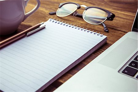 planner - Notepad with laptops and eyeglasses on desk Stock Photo - Premium Royalty-Free, Code: 6109-08395047