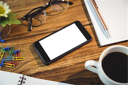 planner - High angle view of office supplies and cellphone on table Stock Photo - Premium Royalty-Free, Code: 6109-08395081