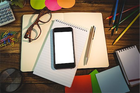 planner - High angle view of mobile phone and office supplies Stock Photo - Premium Royalty-Free, Code: 6109-08395092