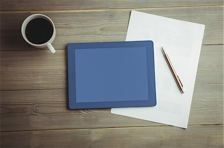 planner - High angle view of digital tablet and document with coffee Stock Photo - Premium Royalty-Free, Code: 6109-08395095