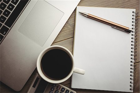 planner - Overhead of notepad with coffee and calculator Stock Photo - Premium Royalty-Free, Code: 6109-08395106
