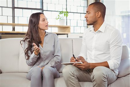 Female patient interacting with male counselor Stock Photo - Premium Royalty-Free, Code: 6109-08395633