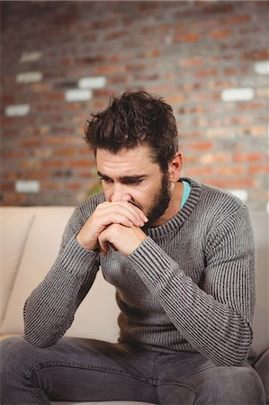 Stressed man with hands in front of mouth Stock Photo - Premium Royalty-Free, Code: 6109-08395845