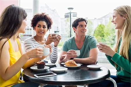 Happy students having coffee together Stock Photo - Premium Royalty-Free, Code: 6109-08395944