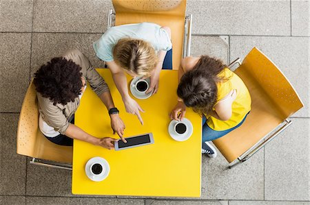 Students using tablet in the cafe Stock Photo - Premium Royalty-Free, Code: 6109-08395917