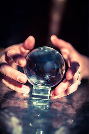 Cropped hands of fortune teller using crystal ball Stock Photo - Premium Royalty-Free, Code: 6109-08396677