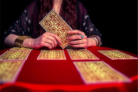 Mid section of fortune teller woman using tarot cards Stock Photo - Premium Royalty-Free, Code: 6109-08396684