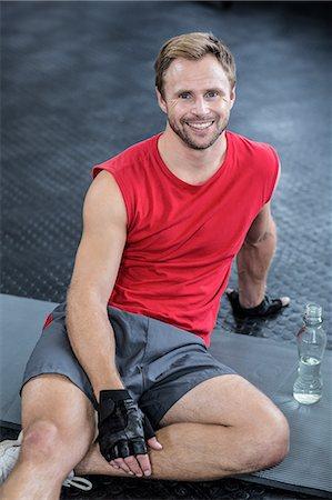 Portrait of smiling muscular man Stock Photo - Premium Royalty-Free, Code: 6109-08396846