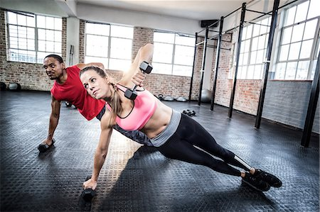 physical fitness - Fit couple doing push ups with dumbbells Stock Photo - Premium Royalty-Free, Code: 6109-08397063