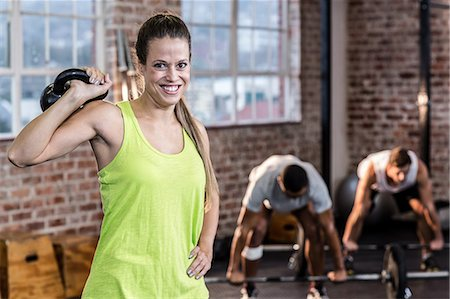 slim - Fit woman working out with kettlebell Stock Photo - Premium Royalty-Free, Code: 6109-08397209