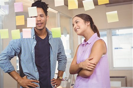 self adhesive note - Business people looking at sticky notes in office Stock Photo - Premium Royalty-Free, Code: 6109-08397372