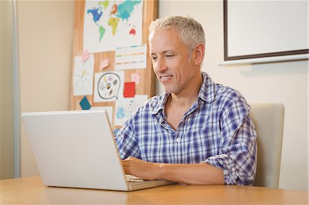 Businessman working on laptop in office Stock Photo - Premium Royalty-Free, Code: 6109-08397473