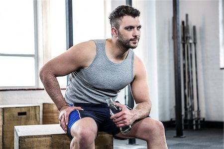 Fit man taking a break from working out Stock Photo - Premium Royalty-Free, Code: 6109-08397751