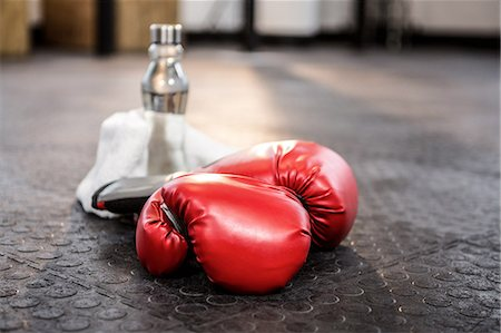 equipment - Boxing gloves on studio floor Stock Photo - Premium Royalty-Free, Code: 6109-08397719