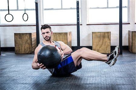 Fit man working out with ball Stock Photo - Premium Royalty-Free, Code: 6109-08397732