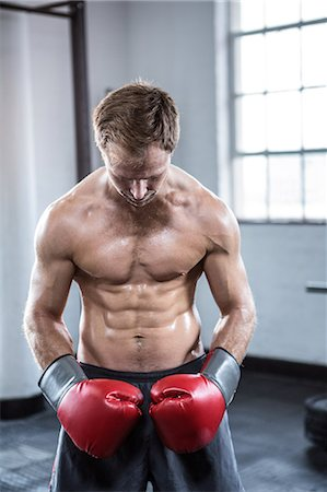 Fit man with boxing gloves Stock Photo - Premium Royalty-Free, Code: 6109-08397867
