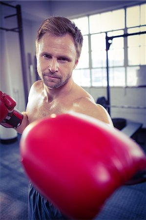 Fit man with boxing gloves Stock Photo - Premium Royalty-Free, Code: 6109-08397866