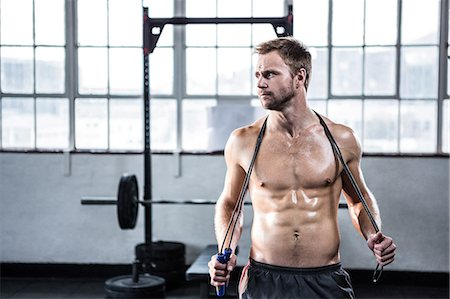 Fit man using skipping rope Stock Photo - Premium Royalty-Free, Code: 6109-08397873