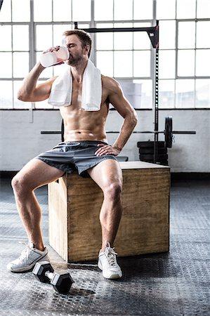 Fit man drinking his protein shake Stock Photo - Premium Royalty-Free, Code: 6109-08397882