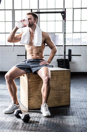 Fit man drinking his protein shake Stock Photo - Premium Royalty-Free, Code: 6109-08397882