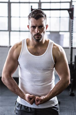 Fit man standing with fists clenched Stock Photo - Premium Royalty-Free, Code: 6109-08397803