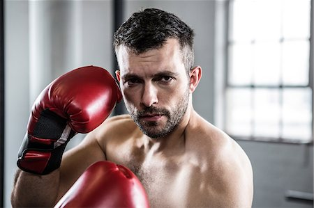Fit man boxing with gloves Stock Photo - Premium Royalty-Free, Code: 6109-08397813
