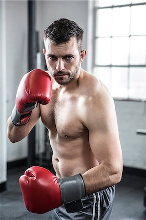 Fit man boxing with gloves Stock Photo - Premium Royalty-Free, Code: 6109-08397812