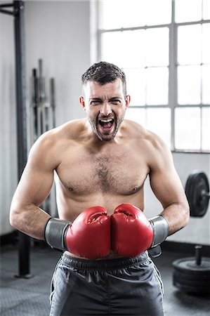 Fit man boxing with gloves Stock Photo - Premium Royalty-Free, Code: 6109-08397815