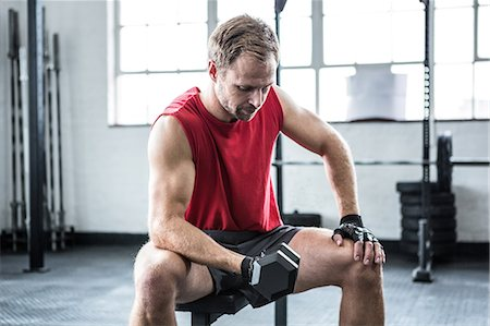 Fit man lifting heavy black dumbbell Stock Photo - Premium Royalty-Free, Code: 6109-08397834
