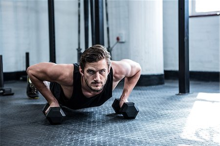 Fit man working out with dumbbells Stock Photo - Premium Royalty-Free, Code: 6109-08397963