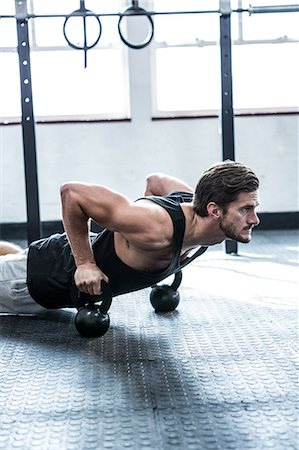 Fit man working out with kettlebells Stock Photo - Premium Royalty-Free, Code: 6109-08397964