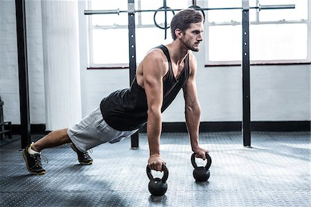 Fit man working out with kettlebells Stock Photo - Premium Royalty-Free, Code: 6109-08397965