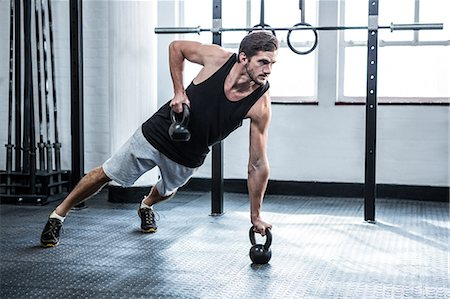 Fit man working out with kettlebells Stock Photo - Premium Royalty-Free, Code: 6109-08397966