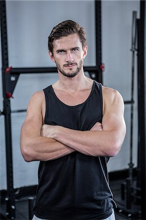Fit man with arms crossed Stock Photo - Premium Royalty-Free, Code: 6109-08397968