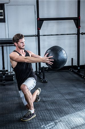 Fit man working out with ball Stock Photo - Premium Royalty-Free, Code: 6109-08397969