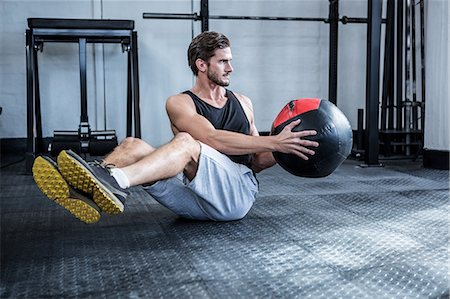 Fit man working out with ball Stock Photo - Premium Royalty-Free, Code: 6109-08397970