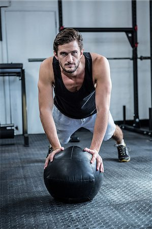 Fit man working out with ball Stock Photo - Premium Royalty-Free, Code: 6109-08397971