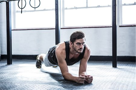 Fit man working out in studio Stock Photo - Premium Royalty-Free, Code: 6109-08397972